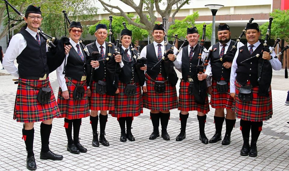 Group photo of all the bagpipers in the Nelson Mandela Artillery pipes and drums band