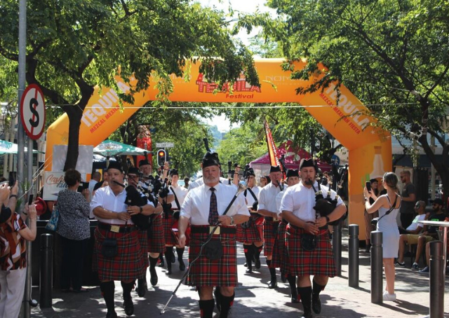 The Nelson Mandela Artillery bagpipes and drums leading a parade at the Tequila Festival