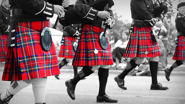 Pipers marching in their Royal Stewart tartan for world tartan day