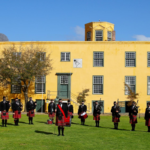 Nelson Mandela Artillery Pipes and Drums in a V formation at the Castle of Good Hope