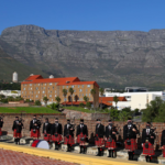 Nelson Mandela Artillery Pipes and drums in the shadowed by Table Mountain