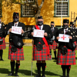 Nelson Mandela Artillery bagpipes and drums showing support for Red Cross hospital