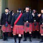 Nelson Mandela Artillery pipes and drums getting ready to practise while marching