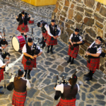 Nelson Mandela Artillery pipes and drums practising their music at the castle in Cape Town