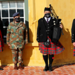 View of Nelson Mandela Artillery pipes and drums uniform and branded masks