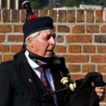 one of the pipers of the Nelson Mandela Artillery getting ready to play