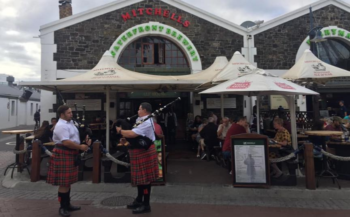 bagpipers playing outside of Mitchells Brewery